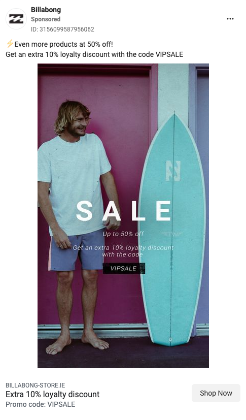 Ad from Billabong showing surfy guy with cheeky smile in board shorts and t-shirt next to a blue surfboard