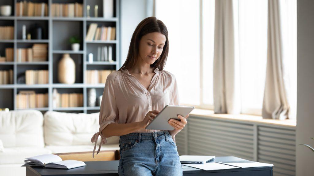 woman at home looking at iPad