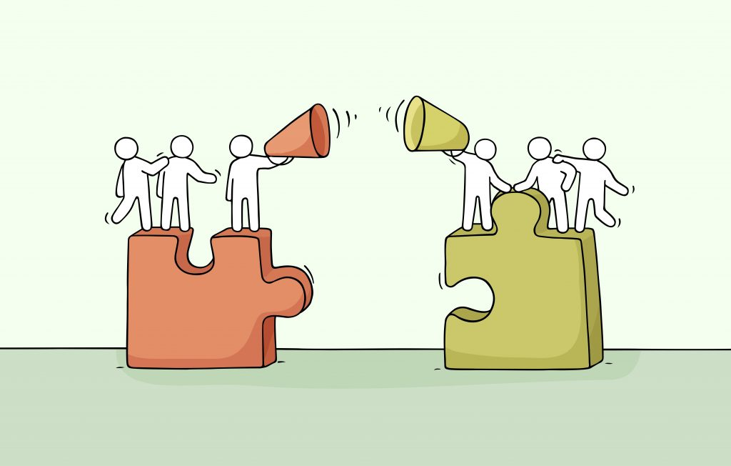 Two pieces of a puzzle with people on top communicating through megaphones